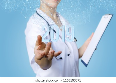Nurse shows numbers 2019 . The concept with the new year.