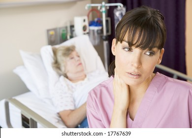 Nurse Standing In Hospital Room,Looking Tired
