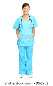 Nurse standing isolated. Young multiracial nurse or medical doctor standing isolated in full length wearing blue scrubs.
