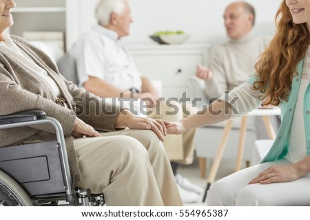 Nurse supporting the charge at nursing home