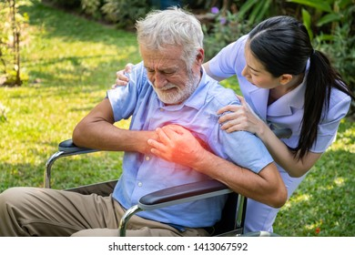 Nurse take care elderly man suffer from chest pain heart attack in garden at nursing home