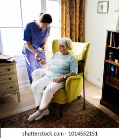 Nurse is taking care of a senior woman