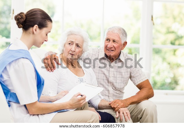 Nurse taking care of sick elderly patients at home