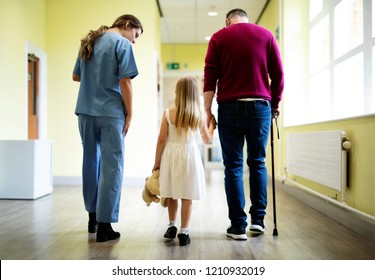 Nurse walking a patient down the hallway
