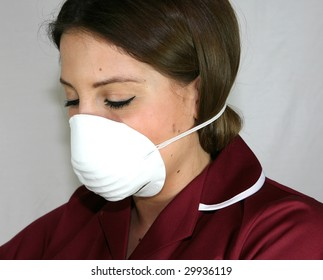 A Nurse wears a face mask to protect against infection