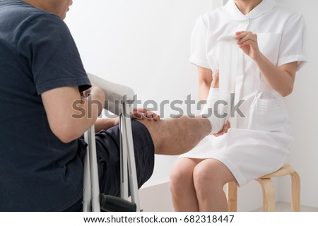 asian nurses shaving male patients