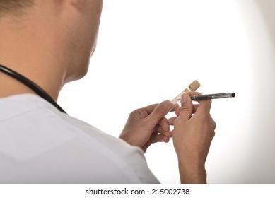 Nurse writing on a tube 01