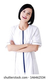 Nurse or young doctor standing smiling. Isolated on white background.