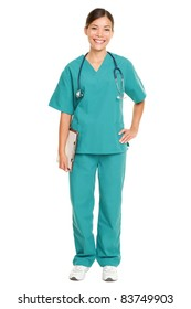 Nurse or young doctor standing smiling isolated on white background in full body. Woman medical professional in green scrubs smiling happy. Mixed race ethnic Chinese Asian and Caucasian female model.