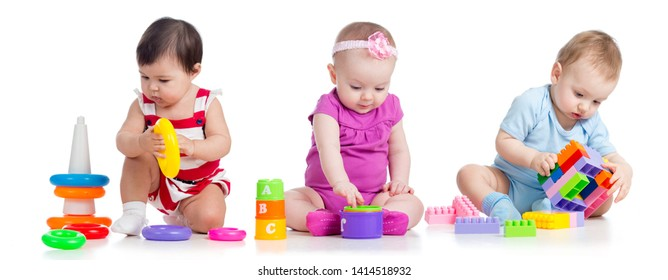 nursery babies with educational toys, isolated on white