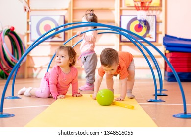 Nursery babies playing together in kindergarten gym