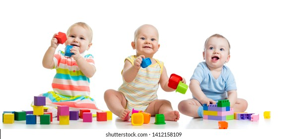 Nursery babies playing with toys isolated on white background
