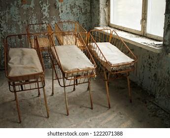 Nursery beds for newborn babies in deserted hospital in Pripyat, Chernobyl Exclusion Zone, Ukraine.