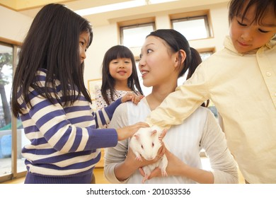 Nursery and children holding her guinea pig