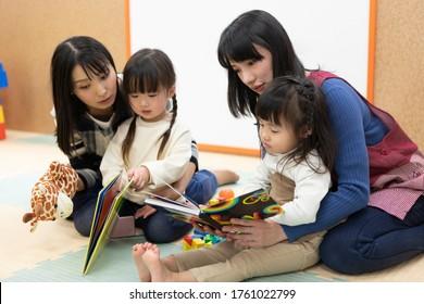 A nursery teacher reading aloud