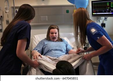 Nurses delivering a baby