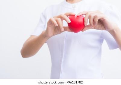 Nurses use hands to show heart shape concept.
