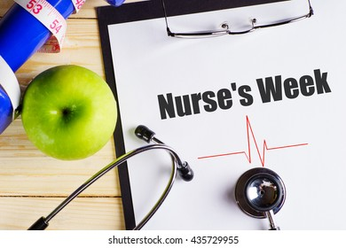 """Nurse's week"" text on paper with heart beat diagram, stethoscope, delicious green apple, measurement tape and blue dumbbell on wooden table - medical, health and disease concept"