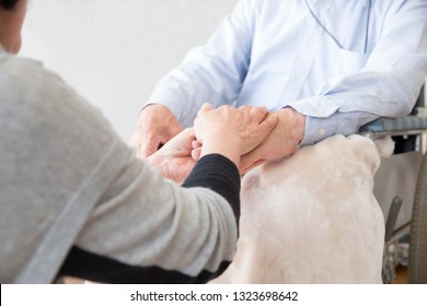 Nursing care, senior, holding hands