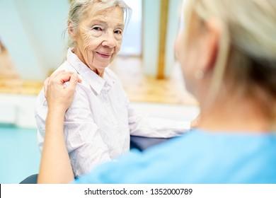 Nursing cares for a senior citizen as a patient with dementia