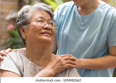 Nursing home with caregiver and old lady resident concept.Care giver hand on happy elderly senior patient to comfort in hospital or hospice nursing home or hospice .Public Service Recognition Week