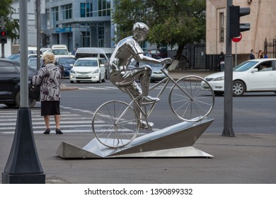Nur-Sultan (Astana), Kazakhstan - August, 2017 -decorative sculpture of a cyclist in Astana