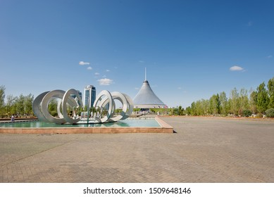 Nursultan (Astana), Kazakhstan, July 2019, Hanshatyr, shopping and entertainment center,  view from the park with abstract sculpture