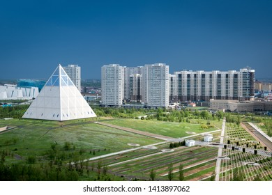 Nur-Sultan, Astana/Kazakhstan - May 15, 2019: Palace of peace and reconciliation in Nur-Sultan/Astana. View of the park and the pyramid from above.