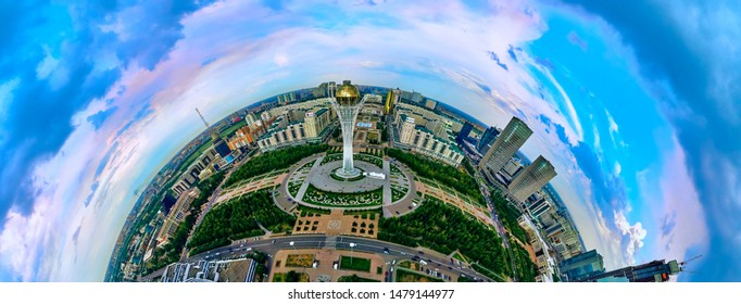 NUR-SULTAN, KAZAKHSTAN - August 11, 2019: Beautiful panoramic (360 spherical panorama little planet) aerial drone view to Nursultan (Astana) city center with skyscrapers and Baiterek Tower