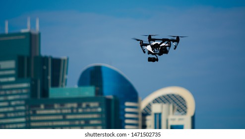 Nur-Sultan. Kazakhstan. August 5, 2019. DJI Inspire 1 Pro. Flying in the city against the backdrop of skyscrapers. Behind the building of the city of Astana (nur-sultan)