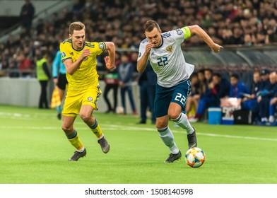 Nur-Sultan, Kazakhstan – March 24, 2019. Russia striker Artem Dzyuba against Kazakhstan midfielder Yan Vorogovskiy during UEFA Euro 2020 qualification match Kazakhstan vs Russia (0-4) in Nur-Sultan.