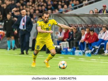 Nur-Sultan, Kazakhstan – March 24, 2019. Kazakhstan national football team defender Gafurzhan Suyumbayev during UEFA Euro 2020 qualification match Kazakhstan vs Russia (0-4) in Nur-Sultan.