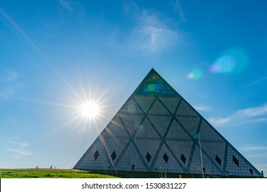 NUR-SULTAN, KAZAKHSTAN - MAY 2019: Astana Palace of Peace and Reconciliation Pyramid Building View on a Sunny Blue Sky Day
