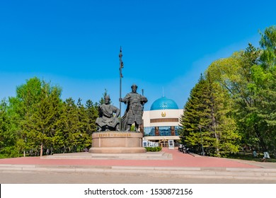 NUR-SULTAN, KAZAKHSTAN - MAY 2019: Astana Kerey and Zhanibek Holding a Spear Statue Street View on a Sunny Blue Sky Day