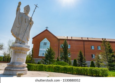 NUR-SULTAN, KAZAKHSTAN - MAY 2019: Astana Our Lady Of Perpetual Help Roman Catholic Cathedral Pope John Paul II Statue View on a Sunny Blue Sky Day