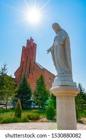 NUR-SULTAN, KAZAKHSTAN - MAY 2019: Astana Our Lady Of Perpetual Help Roman Catholic Cathedral Mother of God Statue View on a Sunny Blue Sky Day