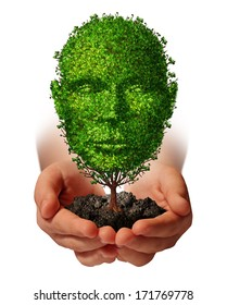 Nurture growth and ?life development concept with a hand holding a green tree shaped as a front view human head as a nature metaphor symbol for protection of the environment and growing potential.
