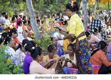 NUSA PENIDA, INDONESIA - AUGUST  13 2016 : Hindu ceremony to celebrate the sea, August 13. 2016 in - Nusa Penida, Indonesia