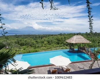 Nusa Penida Island, Indonesia - December 9, 2017: swimming pool with Mount Agung view at Semabu Hills Hotel, Nusa Penida Island