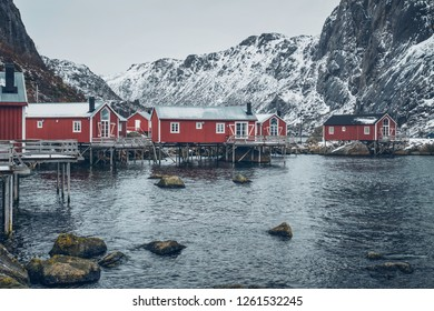 Nusfjord authentic traditional fishing village with traditional red rorbu houses in winter in Norwegian fjord. Lofoten islands, Norway