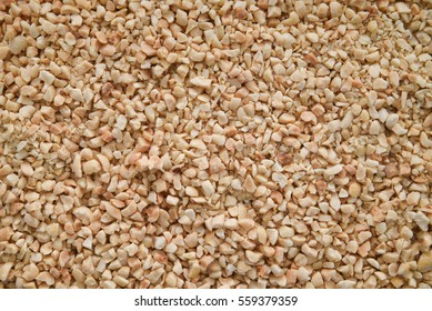 Nut background of crushed or chopped peanuts