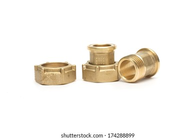 Nut and bolt of gold metal. Photo.