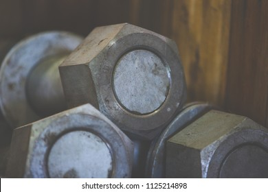 A lot of nut and bolt selective focus only center wooden background with copy space