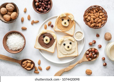 Nut butter banana toast for kids with animal face. Food art, healthy kids meal. Table top view. Healthy eating, healthy lifestyle, kids meal, kids menu, dieting, vegan concept