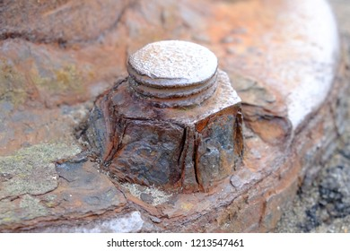 Nut and flange covered with rust