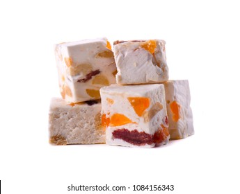 Nut nougat with dried fruit, sweet candy isolated on white background