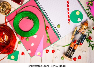The Nutcracker and Christmas accessories on rustic white woody background. Copy space