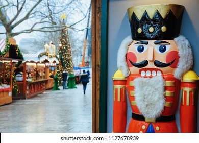 Nutcracker at Christmas Market at Kaiser Wilhelm Memorial Church in Winter Berlin, Germany. Advent Fair Decoration and Stalls with Crafts Items on the Bazaar.