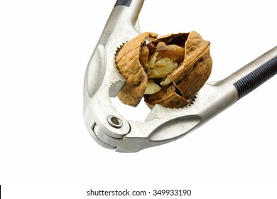Nutcracker cracks walnut, closeup with selected focus, completely isolated on a white background, concept for force, pressure and assertiveness