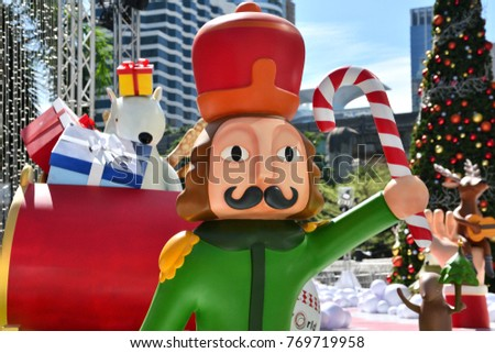 nutcracker holding candy cane with santa claus sleigh polar bear christmas tree and presents - Fiberglass Christmas Decorations